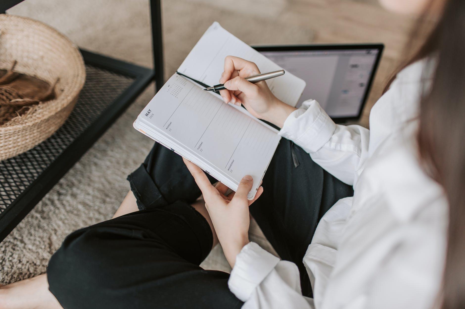 a girl journaling- blogging tips